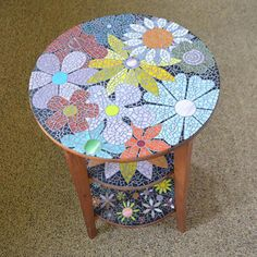 Mosaic Side Table Hand cut glass on wood. Three shelves on this round table are adorned with colorful flowers. Top 18 D, Middle Bottom Mosaic Tile Art, Wood Mosaic, Mosaic Crafts, Mosaic Glass, Stained Glass, Iridescent Tile, Mosaic Flowers, Mosaic Patterns, Wood Pallets