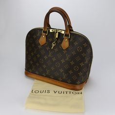 Sac à main Louis Vuitton Alma PM Authentique d occasion en toile Monogram  Prix  53ba958aaa7