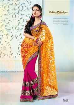 """Enjoy each and every step of your life's journey by wearing this designer saree. A fascinating combination of cherry pink with orange net Brasso (pallu) and navy blue georgette patti. The horizontal patti stich patta design giving out the latest trendy look to any woman at her every occasion. The golden foil touch on the Brasso (pallu) adds to the overall look, touch and feel of the Saree. Having contrast color blouse material. """"Fashion with Tradition."""""""