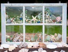 This vintage 6-pane window is hand decorated with found sea glass and other treasures from the sea. It is ready for hanging in the window of your: