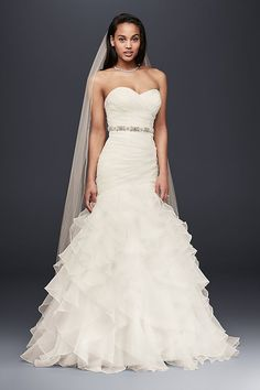 Precise pleats and romantic ruffles offer a contrast of texture and technique on this curve-hugging organza mermaid gown. The lace-up back ensures a perfect fit.   David\'s Bridal Collection  Polyeste