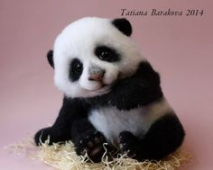 Needle felted panda bear by Tatiana Barakova.