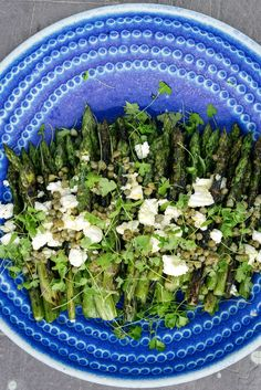 "Grilled Asparagus with Caper Salsa and Caprino fresco, a soft, tangy Italian goat cheese from Yotam Ottolenghi's ""Middle Eastern take on a proper English garden party"" 