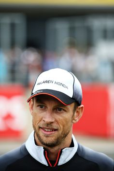 Jenson Button Photos - Jenson Button of Great Britain and McLaren Honda talks to fans in the grandstand during previews ahead of the Formula One Grand Prix of Great Britain at Silverstone on July 7, 2016 in Northampton, England. - F1 Grand Prix of Great Britain - Previews