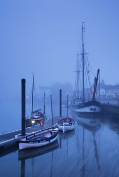 Fog over harbour and boats at dawn, Wells-next-the-sea, North Norfolk Coast, UK Art Print by liamgrantfoto Norfolk Coast, Norfolk England, Wells Next The Sea, Norwich Norfolk, British Isles, British Seaside, English Countryside, Great Britain, Tall Ships