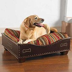 Labs make good bird hunting dogs.  KING RANCH DOG BED  A dog bed fit for a King! The top of the bed is a soft fabric cushion and the leather sided bed features antique nailhead trim and design. Built to last with a hard wood maple frame. krsaddleshop.com