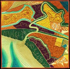 Threading the Past map art quilt by Linda Gass. Artist Statement: This is a contemporary aerial view of the wetlands and salt ponds near Newark in the San Francisco Bay. The stitching lines that overlay the landscape are based on historic maps that show the former shorelines and wetlands channels of the bay, before much of the development was done.