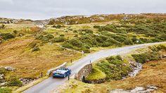 he Audi R8 Spyder traversing the Scottish Highlands' roads.