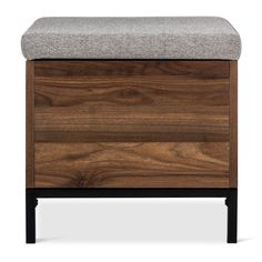 "• Metal frame<br>• Walnut-colored finish<br>• Cushioned top<br>• Hidden storage<br>• 17Hx17.5Wx17.5D""<br><br>Keep blankets, pillows, games or books hidden with the Threshold Storage Cube in Walnut. Clean lines and a beautiful walnut finish give this cube a timeless look. The cushioned top can double as extra seating and it comes completely off for easy access."