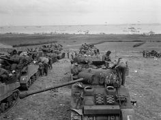 Sword Beach, the morning of June 7, 1944. A Sherman Firefly in the foreground.