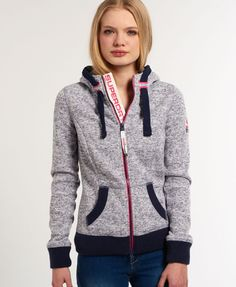 Superdry women's Storm Zip Hoodie. Inspired by mountaineering wear, this zip through hoodie features a drawstring hood with contrasting colour trim, two front pockets and thick ribbed cuffs and hem. The hoodie has a zip fastening with a Superdry logo tab underneath and is finished with an embroidered logo on the shoulder and a Superdry Mountain logo patch on the sleeve.