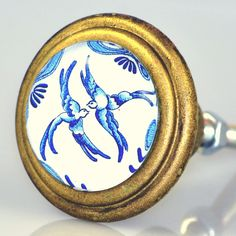 #Blueandwhite #LoveBirds under glass set in #brass. Designed in #Charleston for birdwatchers anywhere ! #cabinethardware