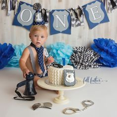 Officer Liam reported for cake smash duty, as he prepares to turn the big O-N-E this Friday!   Police outfit: Wild Child Imagination Boutique Cake: Batter Up Custom Cakes Set Design: Farmhouse Chic  #tulsacakesmashphotographer #smashcake #policecakesmash #babyphotography