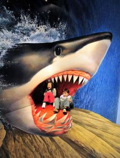 Kids won't really mind staying inside a shark's vicious mouth. Trick art of 3D paintings    http://www.3dvscreens.com/