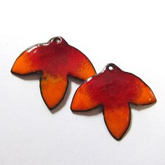 Lotus petal shapes are cut from copper sheet, hammered into shape, drilled, enameled and fired several times in a kiln to create these colorful enamel charms. Imagine what you can create with these handmade earring components. Youll receive the charms in image 1. This sale is for 2 handmade enamel findings as shown in the pictures. c2597  Size: 1 1/4 x 1 1/16 (32 mm x 28 mm) Backs are red enamel as shown. The flower dangles are slightly domed or convex. Vitreous enamel on copper Lo...