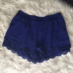 💠 Scalloped Trim Shorts with Pockets With side pockets, pleated, NWT, and no odors, stains, tares. 28 waist and 13 in long.    👑 Welcome to my closet 😊 Reasonable OFFERS are welcomed  🚫 No Trades on this item 🎀 I do bundles  👍 Contact me before buying Ill change the price for discounted shipping 🍭Thank you for visiting my closet! Dresses