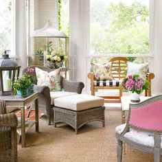 Elements from indoor decor—floral prints, an antique bird cage, even nailhead trim—combine for a romantic look on this summer porch from Midwest Living.