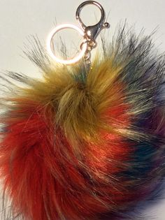 Hello, Animal Lovers!    Decorate your bag or purse with this beautiful accessory!    -This pom pom keychain was made with 100% faux fur    -The feel of the pom pom is softer than many other pom poms on the market    -The pom pom's synthetic fibers are made of Kanecaron, which is modified acrylic (modacrylic) fiber    -The pom pom feels like fur but you can rest assured that it is synthetic so no cutie pies were harmed in the production of this pom pom    -The Red+Taupe/Black pom pom…