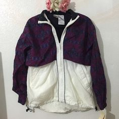Vintage Nike Windbreaker Brand new with tags Vintage Nike Windbreaker. Women's size medium. Oversized fit. Has two front pockets and a drawstring hem line. Nike Jackets & Coats