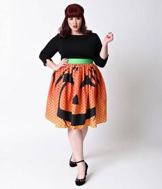Carve out some good times with the cutest pumpkin in the patch, darling! This two faced jack olantern from Unique Vintage is a haunting orange ombre with a smiling demeanor on the front but a scowling expression on the back. Detailed with black polka dot