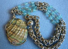 Wire wrapped abalone pendant on a chainmaille with faceted aqua chalcedony beads by EileensBeadedJewelry, $74.00 #wirewrap #chainmaille #abalonenecklace