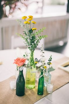 centerpieces with mismatched green bottle vases. Changed to your colors Wedding Bottles, Wedding Vases, Rustic Wedding Centerpieces, Wedding Arrangements, Wedding Table, Floral Wedding, Floral Arrangements, Wedding Flowers, Wedding Decorations