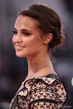 Red carpet hairstyle. Twisted Updo - Alicia Vikander. Celebrity hairstyle.