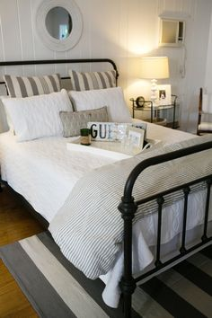 Neutral Striped Guest Bedroom Photography: Bruce Plotkin - www.bruceplotkin.com Read More: http://www.stylemepretty.com/living/2014/10/20/the-picket-fence-project-home-tour/