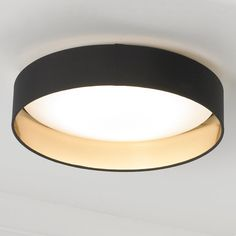 Elegant simplicity defines this ceiling light, which features a dimmable LED array within a white diffuser ringed by a two toned fabric shade.