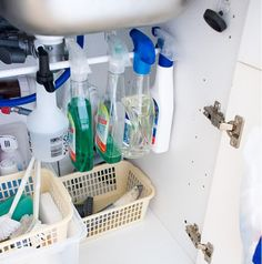 Under the sink organization -tension rod