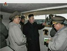U.N. slaps sanctions on North Korea, Kim visits frontline