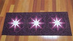 Winter Wonderland ~ Quiltworx.com  Made by Ruth Bushnell  This picture was submitted to us by her good friend Lynn Bull with the below commentary:  My friend Ruth Bushnells table runner.  At 87 she does some mighty fine work.  The star is actually glittery.  Judy..notice the little trim addition.  When we did that to mine in March she liked it so much she used the technique. Table Runner Pattern, Foundation Paper Piecing, Table Runners, Winter Wonderland, Quilt Patterns, Quilting, March, Star, Dining