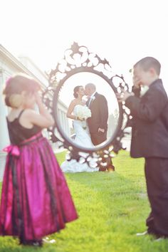 Wedding picture with empty frame framing the couple, held by son and flower girl. Cute wedding pose! AlliChelle Photography » Utah Wedding Photographer | Southern California Wedding Photography