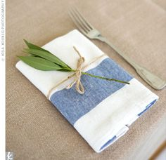 The blue-and-white linen napkins were tied with a string and decorated with a leaf.