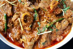 Mughlai Karahi Gosht Slow cooked lamb curry with tomatoes, garlic and garam masala Lamb Recipes, Curry Recipes, Indian Food Recipes, Slow Cooker Recipes, Chicken Recipes, Cooking Recipes, Crockpot Meals, Eid Recipes, Indonesian Recipes