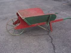 Antique wooden wheelbarrow with metal wheel Kingston Kingston Area image 1