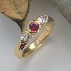 Ruby and White sapphire three stone gold ring Gold And Silver Rings, Silver Jewelry, Bespoke Jewellery, Stone Gold, Bronze Sculpture, White Sapphire, Metal Working, Heart Ring, Wedding Rings