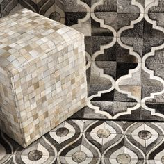 Surya's hair on hide rugs and ottomans in geometric patterns give an original touch to modern style.