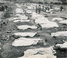 Together in Death / Dead American and German Soldiers lie together awaiting burial. WW2, (place and date unknown)
