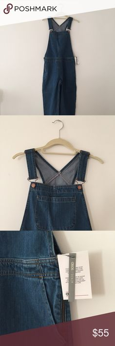 ASOS overalls ASOS denim overalls NWT. Size no longer available online! UK8/ US4 - really cute in person, soft heavy denim. I bought 2 sizes and forgot to return this one, but kept the other pair! I love them, perfect 90s overalls. http://m.asos.com/us/asos/asos-denim-overall-in-stonewash-blue/prd/7924769?iid=7924769&clr=Blue&SearchQuery=Overalls&pgesize=50&pge=0&totalstyles=166&gridsize=2&gridrow=15&gridcolumn=1 ASOS Jeans Overalls