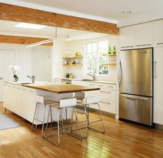 Nothing beats a white kitchen. Exposed beams, island with seating for 4. Reminds me of the kitchen in our first home. Love the modern twist.  kitchen by ras-a, inc.