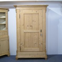 "A tall, slim antique pine single door wardrobe dating from 1900, in very good condition for its age. The door is mounted on the original external hinges allowing it to open fully. This wardrobe totally dismantles so will go up any stairway and through any difficult doorway. It has a depth of 21.5"" so is deep enough for large coats and clothes hangers. Stripped to the bare wood it is now ready for waxing or painting. We will fit a new brass hanging rail for you. Please let us know ..."