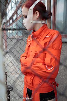 Prisoner in straitjacket