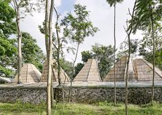Budi Pradono Architects' bamboo house mimics the shapes of nearby buildings and mountains