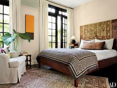 In hairstylist Guido Palau's New York apartment, designer Robert Passal draped a 19th-century Turkish textile over the headboard of a BDDW bed in the master suite.