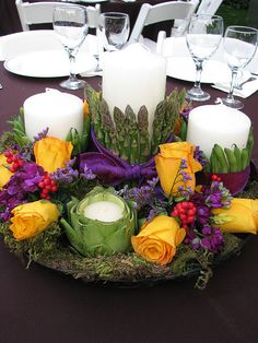 Great use of Asparagas, Snap Peas, Artichokes and berries with flower accents!