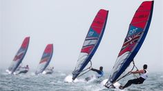 Bryony Shaw (R) of Great Britain competes in the RS:X women's Sailing on Day 5 at Weymouth & Portland.