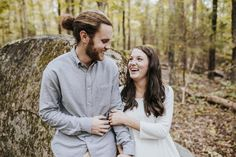 Couples that laugh together have the strongest relationships. Brynn and Caleb's sweet engagement session in a beautiful wooded area of Brynn's family property is on the blog!  Photo by Charlotte, NC Wedding Photographer Kevyn Dixon.