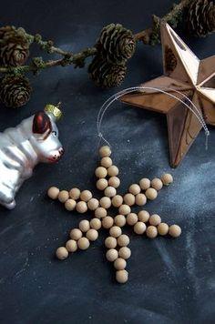étoile de Noël en perles de bois naturelles