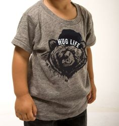 *THE WILD WEST COLLECTION*Our signature 'HUG LIFE' Grizzly Tee pays homage to Cali's well-known rapper, Tupac, and our state Grizzly bear.  Do as the shirt states and 'HUG LIFE' with open arms!  AVAILABLE NOW!!ALTERNATIVE EARTH Eco Heather crew in Heather Grey. Sizes available  3T, 4TSIZES RUN SMALL IN THIS STYLE, SO WE RECOMMEND ORDERING A SIZE UP!Also available in:Organic Cotton Toddler Tee in White.  Sizes available: 2T,4T, 6TOrganic Cotton onesie availabl...